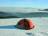 Camping during winter hiking in Carpathian mountains.