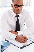 Confident Businessman At Work.
