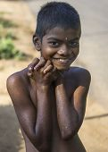 Young Smiling Boy With Red Nails.