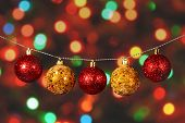 Golden And Red Christmas Ball On The Defocused Background