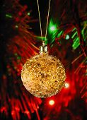 Golden Christmas Ball On The Defocused Background