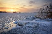 Beautiful Winter Landscape With Frozen Lake And Sunset Sky. Composition Of Nature.