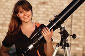 Teen girl and telescope. Near Kiev,Ukraine
