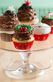 variation of  decorative Christmas cupcake on glass plate