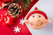 decorated cupcake with Santa helper