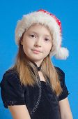 the girl the teenager in Santa Claus's hat