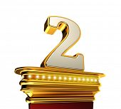 Number Two on a golden platform with brilliant lights over white background