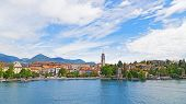 A town waterfront and suburban landscape on the Lake Maggiore in Northern Italy.