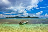 Tropical island at Seychelles and boat - nature background