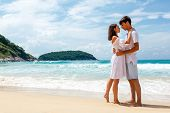 young romantic couple on a beach, copy space left
