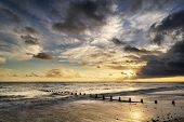 Beautiful Vibrant Seascape At Sunset Image With Dramatic Sky And Colors