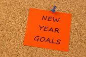 New Year Goals on orange sticky note