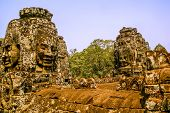Carved faces in Angkor Wat
