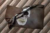 foto of pirate flag  - 3d rendering of a pirate flag on a wooden table - JPG