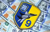 Kiev,Ukraine.Dec 14.Illustrative editorial.Chevron of Ukrainian military officer (air force). 9 Aviation brigade.With money background.At December,2014 in Kiev, Ukraine