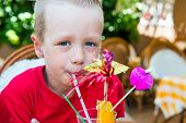 5 Years Old Boy Drinking A Delicious Fruit Cocktail