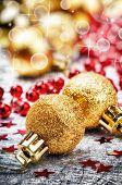 Golden Christmas Balls On Festive Background