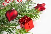 Christmas Tree Branch And Red Decorations