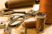 image of tool  - various sewing tools on a wooden surface - JPG