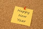 Happy New Year on a yellow sticky note
