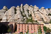 stock photo of tourist-spot  - Benedictine abbey Santa Maria de Montserrat located high in the Montserrat mountain which is a popular hiking and climbing spot for both locals and tourists - JPG