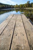 Perspective Of Wooden Picnic Table With Blur Landscape Vertical Background