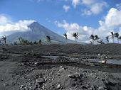 pic of luzon  - river flowing through debris field from eruption of mount mayon volcano albay province luzon island in the philippines