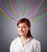 Pretty young girl thinking with colorful abstract lines overhead