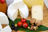 Various Types Of Cheese On Wood