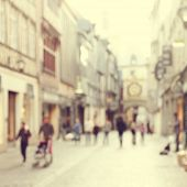 Abstract blurred image of a city street scene.