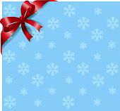 Snowflakes background with red ribbon and bow. Place for copy/text.