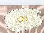 Close Up Gold Ring On Rice Seeds On A Brown Cloth