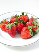 Strawberries In A Plate On White