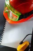 Goggles, Earphones And Red Helmet