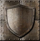 old metal shield over armor background