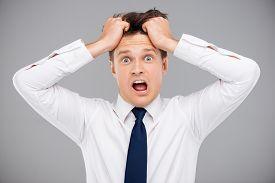 pic of irritated  - Irritated young man tearing his hair - JPG