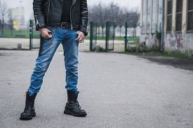 image of anarchists  - Punk guy with boots posing in the city streets - JPG
