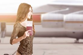pic of runaway  - Woman about to board an airplane in an airport runaway at sunset - JPG