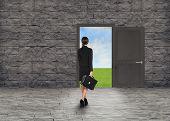 pic of walking away  - Composite image of Businesswoman walking away in room with door - JPG