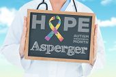 picture of aspergers  - The word asperger and doctor showing chalkboard against blue sky - JPG