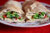 stock photo of humus  - Image of pita wraps with humus and vegetables - JPG