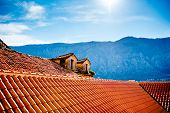 picture of red roof tile  - Top view with tiled red roofs and mountains in Kotor old city in Montenegro - JPG