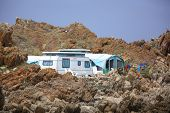 picture of caravan  - Caravan camping near a rocky seaside shore - JPG