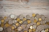 picture of ringgit  - Top view coins on old wooden desk with copy space on top - JPG