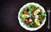image of boil  - Fresh tasty salad with boiled eggs and vegetables in the plate selective focus and blank space - JPG