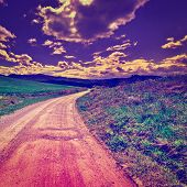 picture of dirt road  - Dirt Road Leading to the Farmhouse in Tuscany Italy at Sunset Instagram Effect - JPG