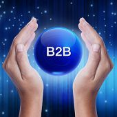 picture of ball chain  - Hand showing blue crystal ball with best word - JPG