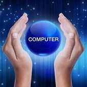 picture of reboot  - Hand showing blue crystal ball with computer word - JPG