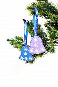 image of christmas bells  - Christmas background Christmas tree branch with bells toys handmade felt - JPG