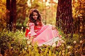 picture of gathering  - cute curly kid girl in pink princess dress gathering dandelion flowers in summer forest - JPG